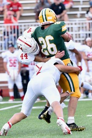 McPherson's Cade Wedel (44) and Trey Buckbee (2) tackle Salina South's Brandt Cox (26) Friday night at Salina Stadium.