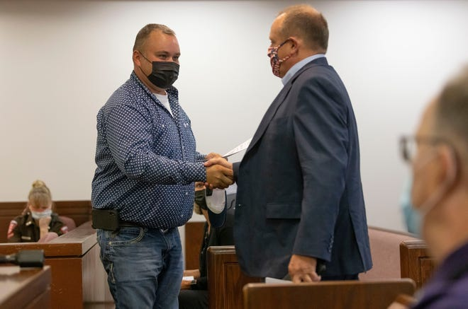 Thomas DeVore, right, arrives to represent Tyson Skinner, left, and his wife, Marcie Skinner, in Sangamon County Circuit Court at the Sangamon County Complex in Springfield, Ill., Friday, September 3, 2021. The Sangamon County Department of Public Health was seeking a court order authorizing the quarantine of four of the Skinner's children who are students in the Pleasant Plains School District after they came in close contact with a middle school student who recently tested positive for COVID-19. [Justin L. Fowler/The State Journal-Register]