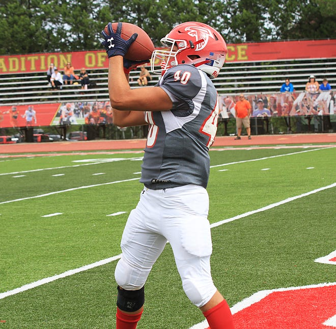Juice Griffith hauls in a touchdown pass for Constantine on Friday.