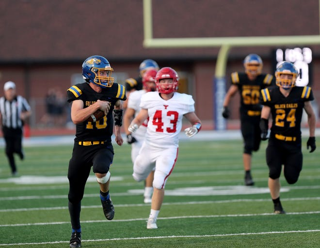 Aberdeen Central quarterback Sam Rohlfs recovers from a bad snap to score a 59-yard touchdown in the second quarter of Friday's game against Yankton at Swisher Field. American News photo by Jenna Ortiz, taken 09/03/2021.