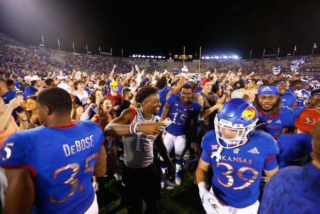 Kansas fans storm the field after their Jayhawks defeat South Dakota 17-14 Friday night at David Booth Kansas Memorial Stadium.