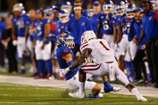 Kansas redshirt junior quarterback Jason Bean slows down before being hit by South Dakota freshman defensive back Myles Harden in the second half of Friday's game at David Booth Kansas Memorial Stadium. Harden would be ejected by the game on this play due to targeting.