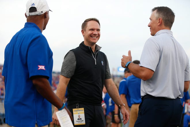 FILE -- Kansas athletic director Travis Goff is greeted ahead of the start of the Jayhawks' football game against South Dakota.