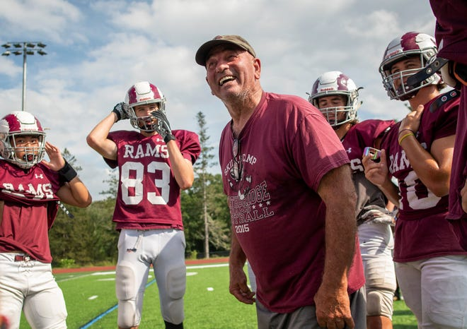 Northbridge High School football coach Ken LaChapelle talks with some of his players during a recent practice at Lasell Field.