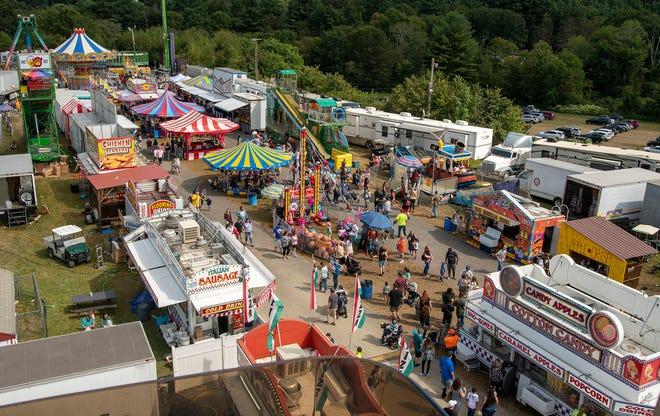 The Spencer Fair midway Saturday. The annual fair runs through Monday.
