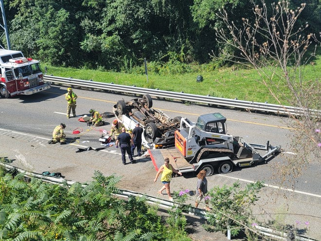 A motorist was trapped in a vehicle in a rollover crash Saturday on Interstate 395 in Oxford. Oxford and Webster police freed the trapped man from the vehicle.