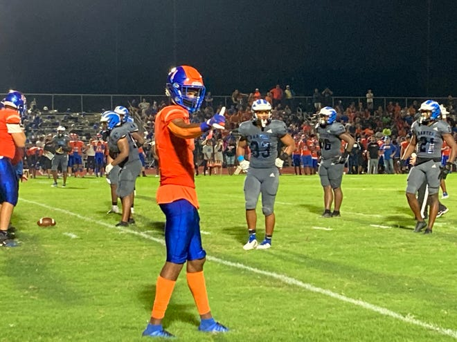 Jayden Gibson signals to an official during West Orange's game at Apopka on Sept. 3, 2021.