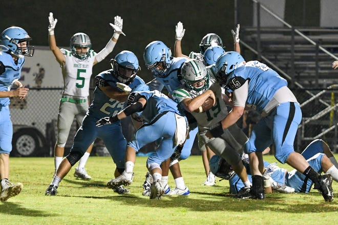 Anderson Morgan (5) gives the touchdown signal as Tucker Griffin (19) plows into the end zone for Hokes Buff during the Eagles' 41-0 victory at Pleasant Valley on Friday, Sept. 3, 2021. Griffin rushed for 91 yards and scored three touchdowns.