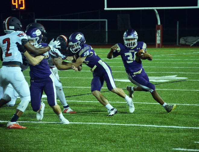 Smithsburg's Ashton Redman (34) finds running room around the edge against Francis Scott Key on Friday night. The Leopards will face Williamsport in this weekend's only matchup between two Washington County teams.