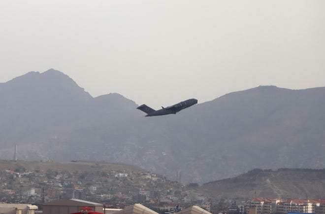 A U.S military aircraft takes off from the Hamid Karzai International Airport in Kabul, Afghanistan, Monday, Aug. 30, 2021.