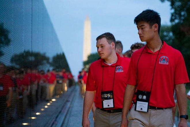 Pictured, from left: William Plank, of Oklahoma, and Andrew Zhao, of Wayland, with other Boys Nation participants at the Vietnam Veterans Memorial.