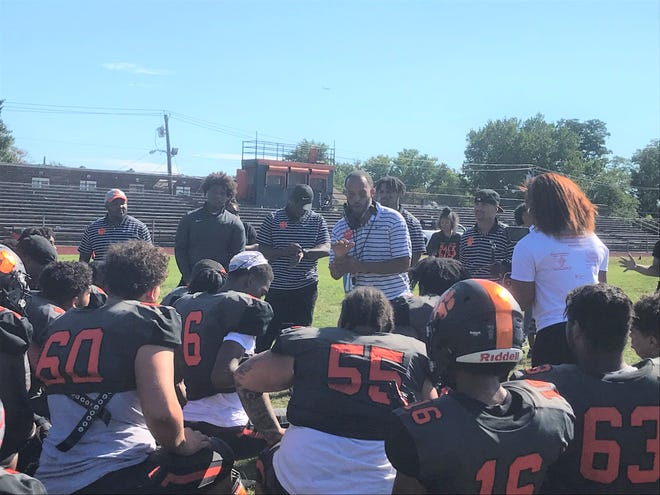 Woodrow Wilson head coach Brandon Bather addresses his team after Saturday's 28-6 win over West Deptford.