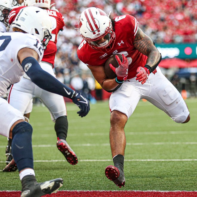 Wisconsin's Chez Mellusi carried the ball 31 times against Penn State