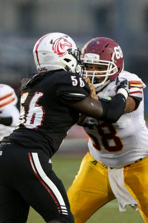 McCutcheon's Myles Jackson (68) blocks Lafayette Jeff's Daeveon Cheeks (56) during the second quarter of an IHSAA football game, Friday, Sept. 3, 2021 in Lafayette.