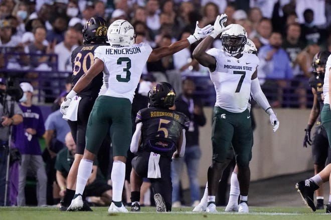 Michigan State safety Xavier Henderson (3) celebrates with safety Michael Dowell (7) after Henderson tackled Northwestern wide receiver Stephon Robinson Jr. (5) during the first half of an NCAA college football game in Evanston, Ill., Friday, Sept. 3, 2021.