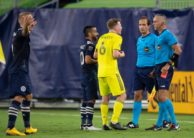 New York City FC midfielder Maximiliano Moralez (10) and Nashville SC midfielder Dax McCarty (6) are issued red cards and ejected from the match after a fight between the two teams during the first half of an MLS game at Nissan Stadium Friday, Sept. 3, 2021 in Nashville, Tenn.
