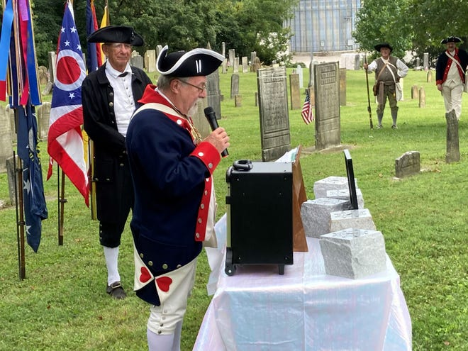 Guest speaker Troy Bailey addresses the crowd in Old Colony Burying Ground Sept 4 as Thomas Hankins listens.