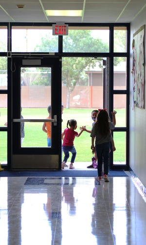 Students at MacArthur Community Elementary School head out to recess on Wednesday, Aug. 18, 2021.