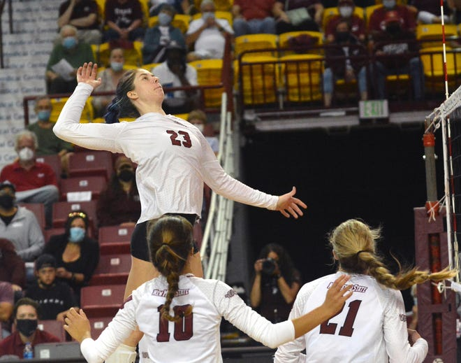 NMSU's Katie Birtcil gets her shot off against Arizona during the third set on Friday at the Pan American Center.