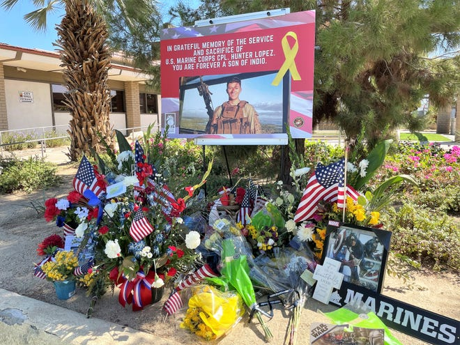 A memorial to fallen Marine Hunter Lopez in front of Indio City Hall. The memorial will remain through Sept. 11 2021, according to city officials.