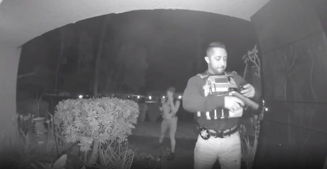 A screenshot from security camera video footage shows bounty hunter Fabian Herrera walking up to the front door of David Spann's Palm Springs condo just after 2 a.m. on April 23.