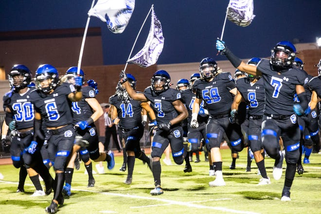The Chandler Wolves take the field before the Chandler vs. Centennial Coyotes high school football game at Austin Field in Chandler, Sept. 3, 2021.