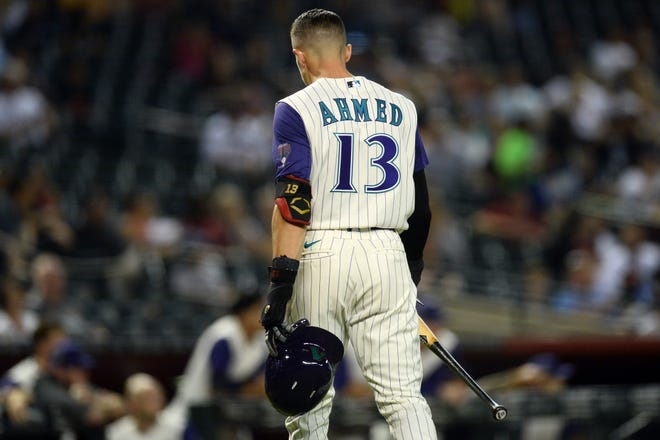Arizona Diamondbacks shortstop Nick Ahmed (13) returns to the dugout after striking out against the Seattle Mariners during the first inning at Chase Field on Friday, Sep. 3, 2021.