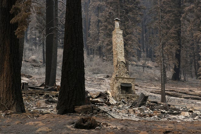 A home destroyed by the Caldor Fire is seen along Highway 50 near South Lake Tahoe on Sept. 3, 2021.