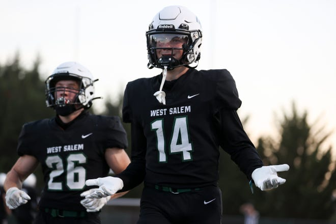West Salem's Zach Dodsen Greene (14) celebrates after a touchdown against the Newberg Tigers during the second quarter of the game at West Salem High School in Salem, Ore. on Friday, Sept. 3, 2021.