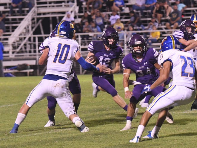 Mason High School's Ryne Todd (12) runs with the ball while Jaden Scantlin (34) provides blocking during a nondistrict high school football game against Comfort Friday, Sept. 3, 2021, at R. Clinton Schulze Stadium in Mason.