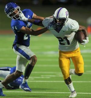 San Angelo Lake View's Derrick Taylor, left, gets stiff armed by Pecos running back Ezekiel Sandana at San Angelo Stadium on Friday, Sept. 3, 2021.