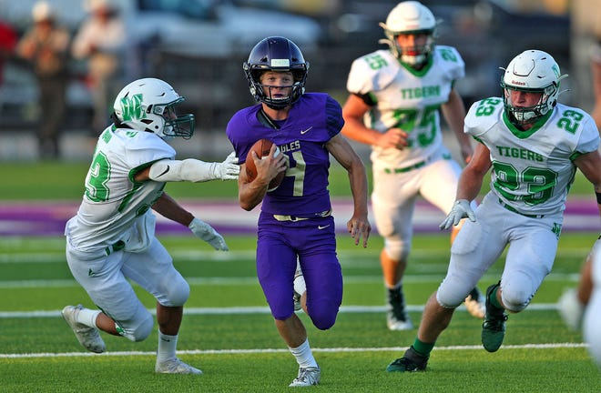 Kas Johnson (4) rushes the ball for Sterling City during a game against May on Friday, Sept. 3, 2021.