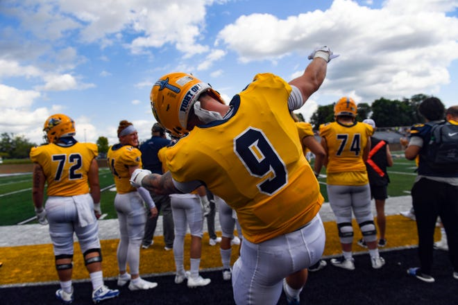 Augustana's Jarod Epperson dances to music on the sidelines between plays in their first home football game of the season on Saturday, September 4, 2021 at Kirkeby-Over Stadium in Sioux Falls.