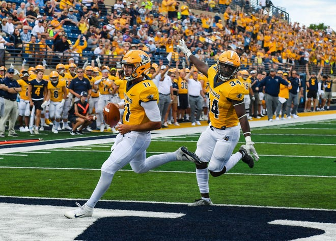 Augustana quarterback Kyle Saddler runs the ball in for a touchdown as teammate David Addo celebrates behind him in their first home football game of the season on Saturday, September 4, 2021 at Kirkeby-Over Stadium in Sioux Falls.