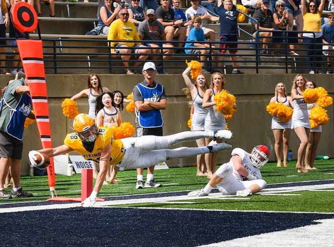Augustana's Sean Engel leaps sideways for a touchdown during the first home football game of the season on Saturday, September 4, 2021 at Kirkeby-Over Stadium in Sioux Falls.