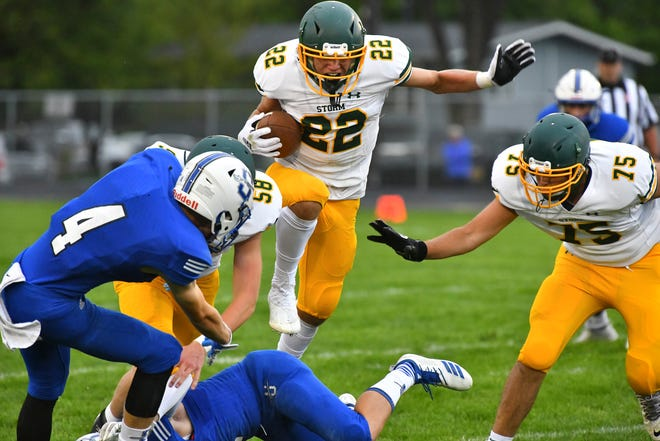 Andrew Harren of Sauk Rapids leaps over players for a gain during the game Friday, Sept. 3, 2021, in Sartell.