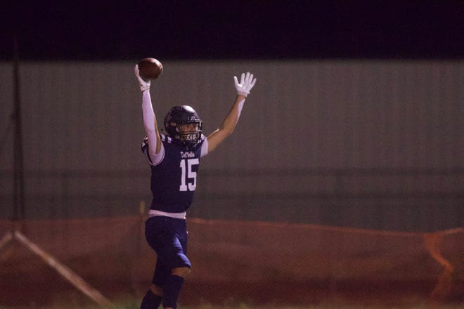Del Valle's Eli Molina celebrates his 34-yard touchdown reception on 4th and 15 with 25 seconds left in the first half Friday against Pebble Hills