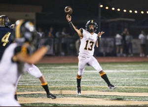 Quarterback Joey Reynoso fires a pass on the run during Ventura's 32-14 victory at Dos Pueblos on Friday, Sept. 3, 2021. Reynoso threw for 229 yards and four touchdowns.