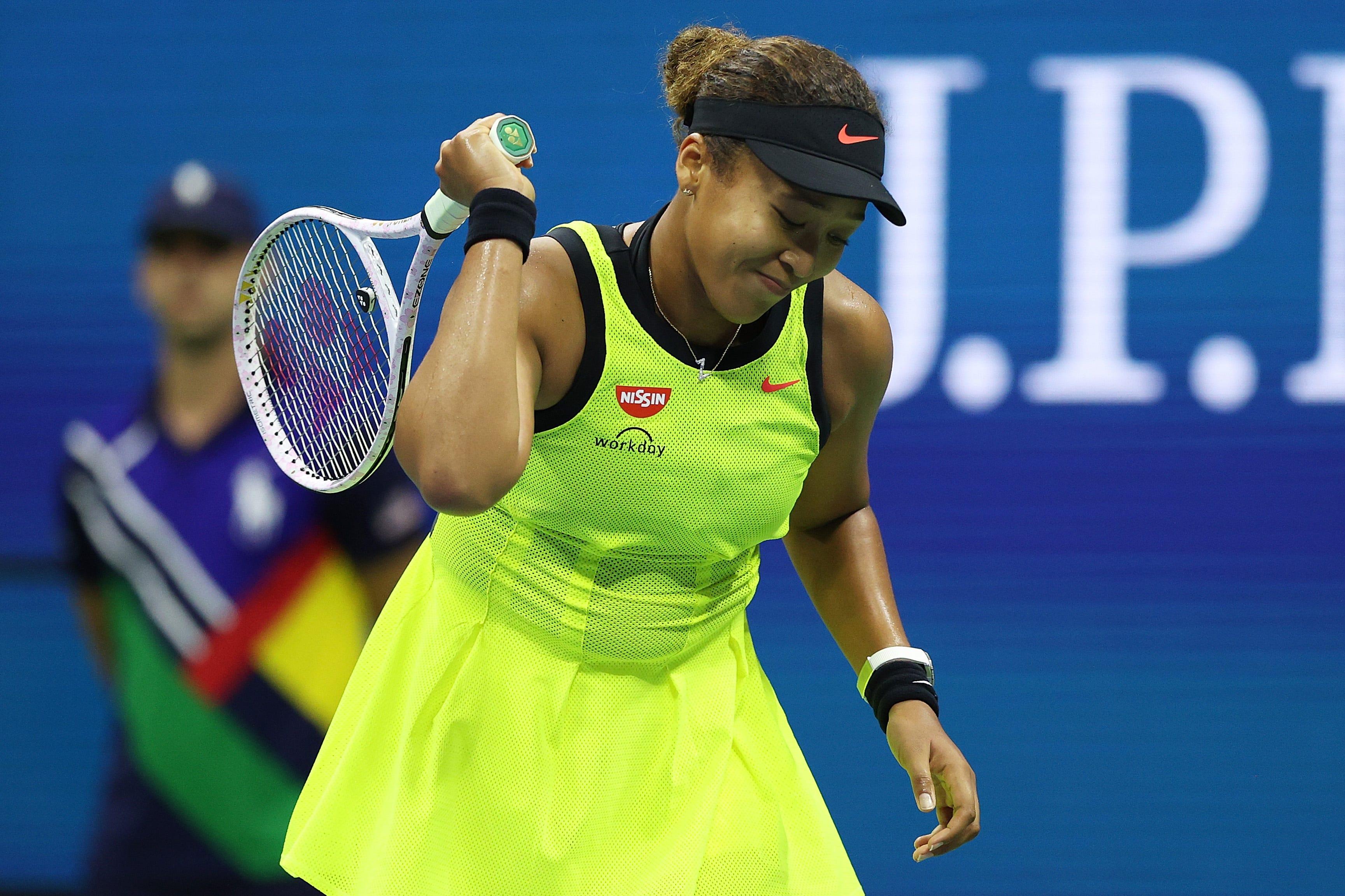 Naomi Osaka slams racket several times, screams and leaves court in three-set loss