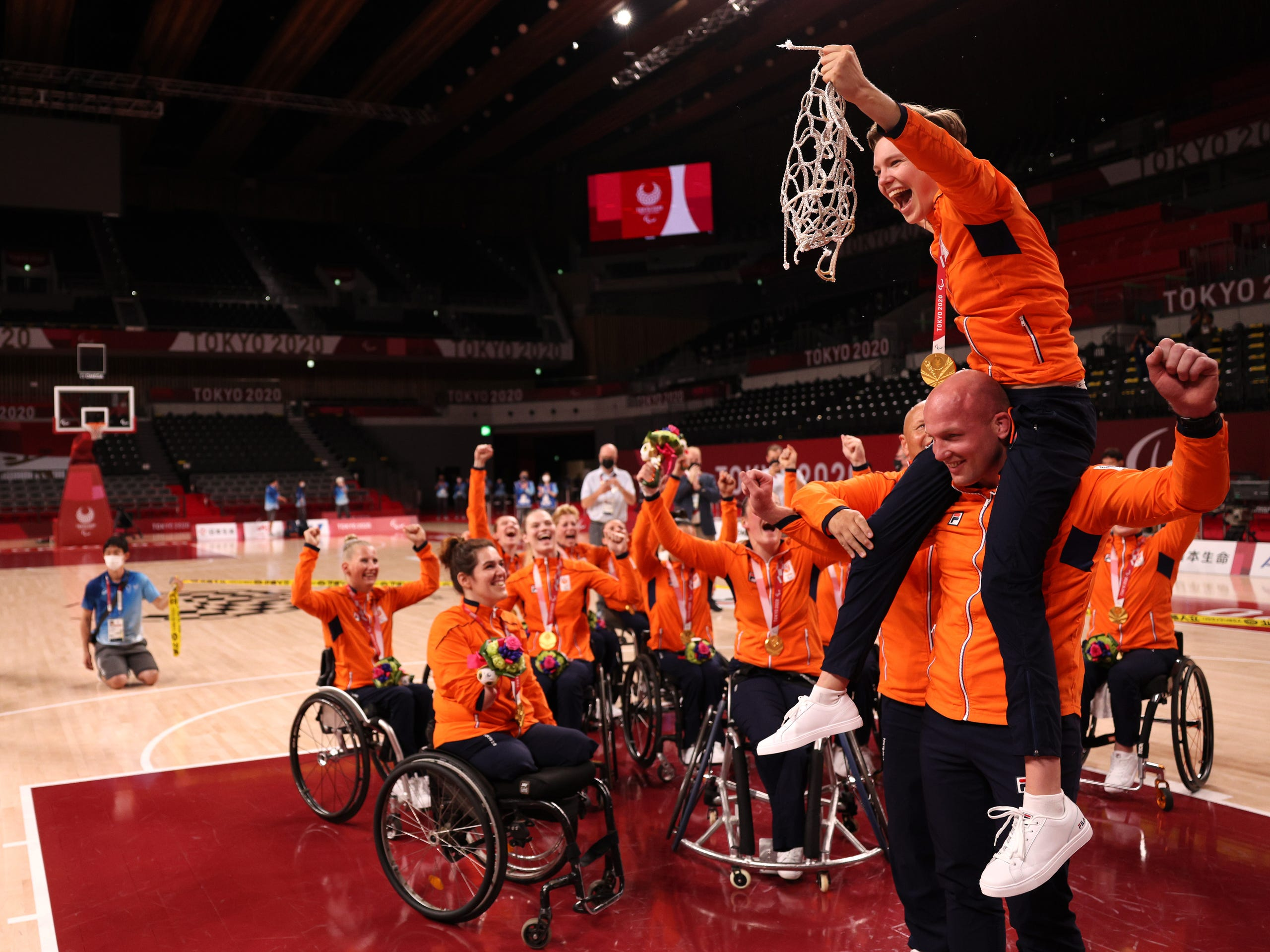 Sept. 4: Gold medalist Bo Kramer #9 of Team Netherlands cuts down the net to celebrate with her team during the women's Wheelchair Basketball medal ceremony on day 11 of the Tokyo 2020 Paralympic Games at Ariake Arena.