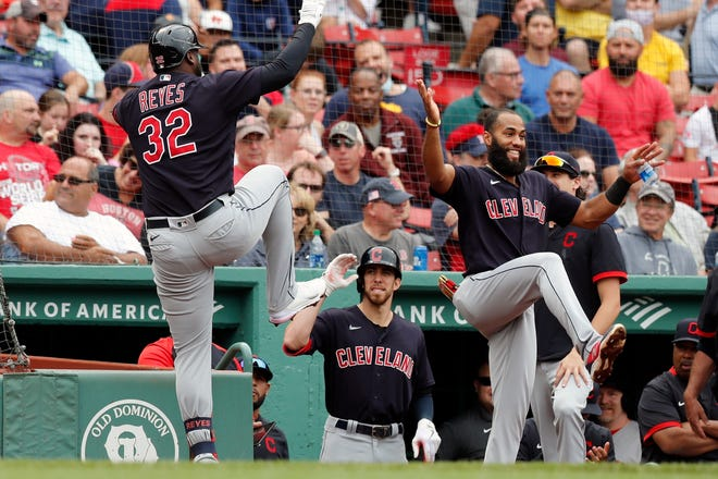 Cleveland's Franmil Reyes (32) celebrates his solo home run during the third inning of a baseball game against the Boston Red Sox, Sunday, Sept. 5, 2021, in Boston. (AP Photo/Michael Dwyer)