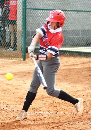 Junior Emma Jones drives in Lady Gamecock baserunners in a SCHS 10-0 victory over visiting Claxton on Aug. 31.