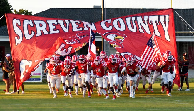 After waiting additional weeks because of a school system pandemic shutdown, the 2021 Gamecocks run onto the field at Kelly Memorial Stadium Sept. 3 for Screven County's regular season opener against Hephzibah.