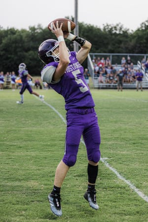 Parker Francis brings down a pass at Friday's game against Webbers Falls.
