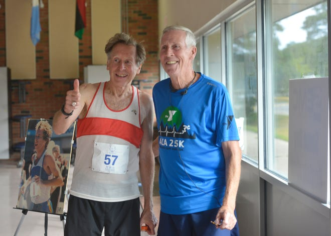 Bill Rodgers, left, poses for a photo with Jim Walsh of Pembroke before Sunday's road races. Rodgers is a four-time Boston Marathon and New York City Marathon winner. He was the special guest at Sunday's race. He was running the five-mile race. Walsh ran the 10-mile race.