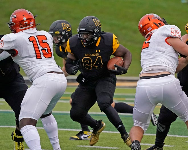 Adrian College running back Steven Moses (24) rushes with the ball during the Bulldogs' season opener against Heidelberg on Saturday evening at Docking Stadium.