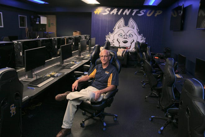 """Bob Metz, who retired last week as Siena Heights University's chief information officer after 41 years with the university, is pictured Aug. 31 in SHU's e-sports room. The addition of e-sports came as """"kind of a surprise,"""" Metz said."""
