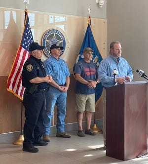 Shown are local officials speaking at a press conference. Pictured from left are: Ascension Parish Sheriff Bobby Webre, State Rep. Clay Schexnayder, State Sen. Eddie Lambert. and Ascension Parish President Clint Cointment.