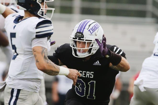 Iowa Wesleyan University's Chance Colby (31) pressures quarterback Josh Munn (5) their home game against Missouri Baptist University Saturday Sept. 4, 2021, at Mount Pleasant's Mapleleaf Athletic Complex.