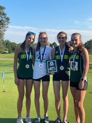 Geneseo High School cross country runners, from left, Jaide Flowers, 11th; Jessalyn Belvel, 16th; Anna Snyder, 6th; and Katlyn Seaman, 17th, received medals in the Annawan-Wethersfield Invitational held Monday, Aug. 30, at Kewanee Dunes Golf Course in Kewanee.